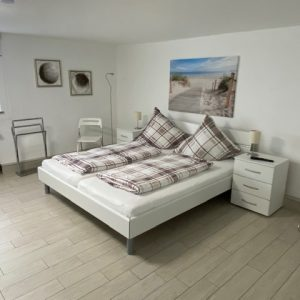 Schlafzimmer mit einem Doppelbett, Ferienhaus Nordseeperle
