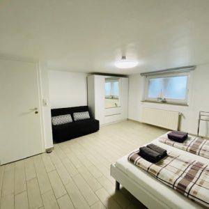 Schlafzimmer mit einer Schlafcouch, Ferienhaus Nordeeperle